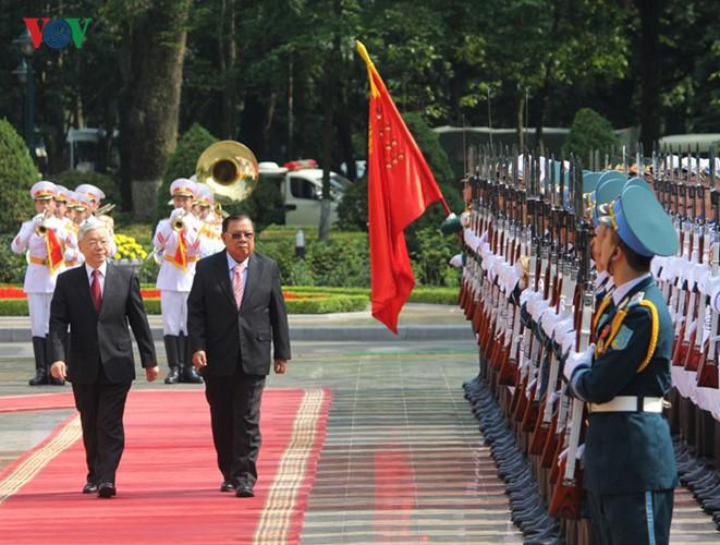 Lễ đón chính thức Tổng Bí thư, Chủ tịch nước Lào tại Hà Nội - ảnh 8