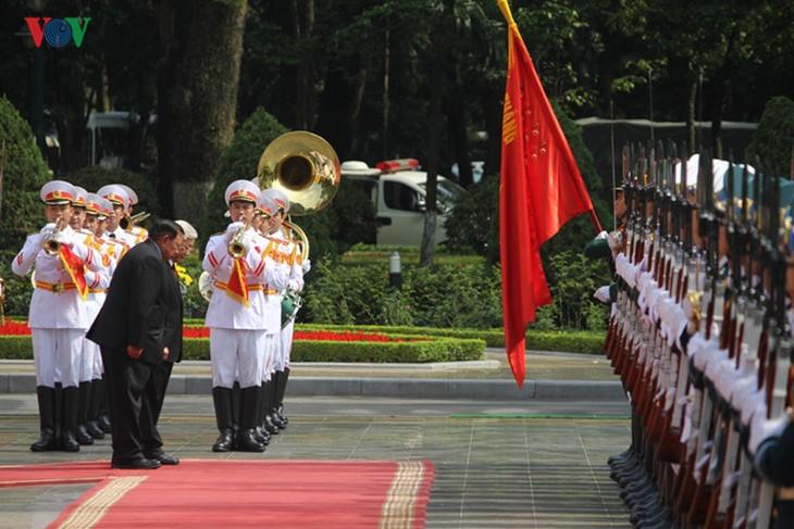 Lễ đón chính thức Tổng Bí thư, Chủ tịch nước Lào tại Hà Nội - ảnh 7