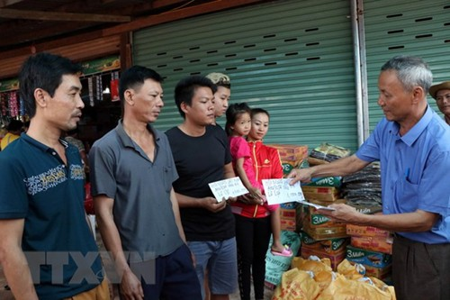 Vỡ đập thủy điện tại Lào: Cộng đồng người Việt Nam chung tay giúp người dân Lào khắc phục sự cố  - ảnh 1