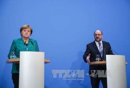 พรรคคริสเตียนเดโมเครติกยูเนียนหรือ CDU อนุมัติข้อตกลงจัดตั้งพรรคร่วมรัฐบาลเยอรมนีกับพรรค SPD - ảnh 1