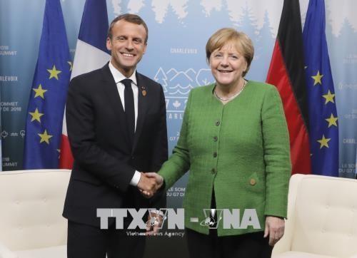 เยอรมนีและฝรั่งเศสอยากปรับปรุงโครงสร้างหนี้ของเขตยูโรโซน - ảnh 1