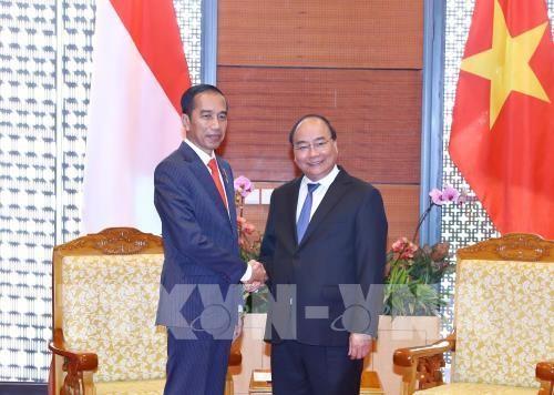นายกรัฐมนตรีเหงวียนซวนฟุกให้การต้อนรับประธานาธิบดีอินโดนีเซีย ประธานและผู้อำนวยการใหญ่เครือบริษัท GE Global - ảnh 1