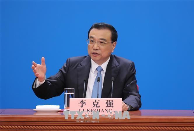 จีนมีท่าทีที่แข็งกร้าวต่อนโยบายคุ้มครองการค้าของสหรัฐ - ảnh 1