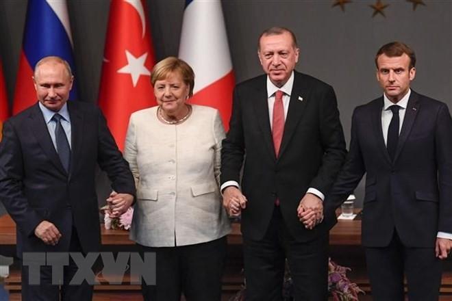 รัสเซีย ฝรั่งเศส เยอรมนีและตุรกีออกแถลงการณ์ร่วมเกี่ยวกับปัญหาซีเรีย - ảnh 1