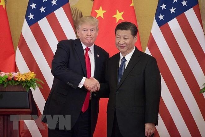 ผู้นำสหรัฐและจีนเจรจาทางโทรศัพท์เกี่ยวกับปัญหาด้านการค้า - ảnh 1