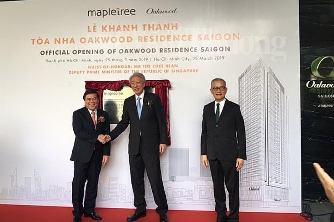 รองนายกรัฐมนตรีสิงคโปร์เยือนโครงการก่อสร้างอาคารสำนักงาน V Plaza - ảnh 1