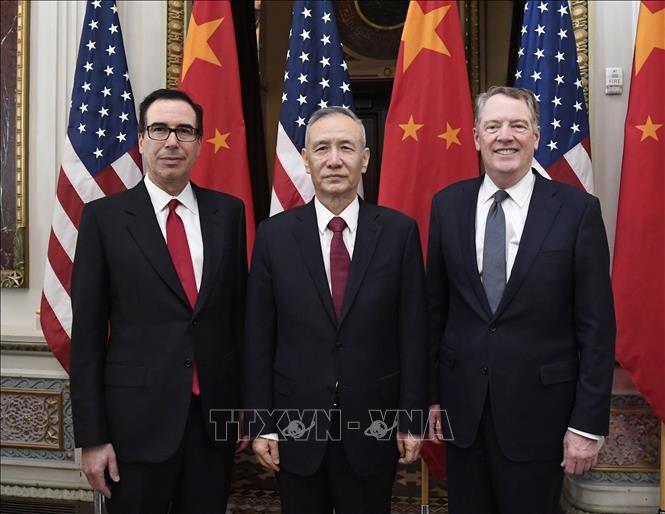 สหรัฐและจีนเสร็จสิ้นการเจรจานัดแรกเกี่ยวกับปัญหาการค้า - ảnh 1